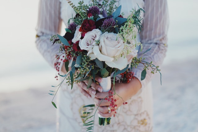 woman-holding-red-and-white-rose-bouquet-759668